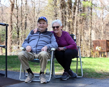 Spring weather features in Leominster. Bert and his wife Ginette LeBlanc of Leominster sit in their front yard on Iris Road on a warm spring day. JULIA MALAKIE/LOWELLSUN