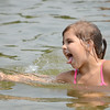 Peyton Lyons, 5, splashes around in the water at The Beach at Emerald Place at Lake Whalom in Lunenburg on Friday afternoon. SENTINEL & ENTERPRISE / Ashley Green