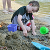Trace Davin, 6,  builds a sandcastle at The Beach at Emerald Place at Lake Whalom in Lunenburg on Friday afternoon. SENTINEL & ENTERPRISE / Ashley Green