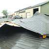 Parts of the roof of Southside Automotive Service lay behind the building after strong winds from thunderstorms ripped the roof off the front of the building at 1335 W. 53rd Street Friday afternoon.