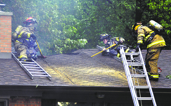 Anderson firefighters battled a blaze at 2725 Redbud Lane Friday afternoon after a tree fell on a power line in the back yard due to high winds from strong thunderstorms that  moved through the area.