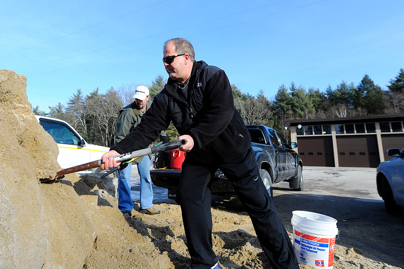 Lunenburg residents Danny Gonzalez (near) and Ethan Adams stock up on sand for themselves from the Lunenburg DPW, Tuesday, in preparation for the forecasted winter storm on Thursday.<br /> SENTINEL & ENTERPRISE / BRETT CRAWFORD