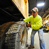 Fitchburg DPW worker Vinny DeCaria puts a chain onto a vehicle, Tuesday, in preparation for the forecasted winter storm on Thursday.<br /> SENTINEL & ENTERPRISE / BRETT CRAWFORD