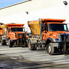 Trucks that have already been prepped and equipped with tire chains sit at the Fitchburg DPW yard, Tuesday, ready to go to work for the forecasted winter storm on Thursday.<br /> SENTINEL & ENTERPRISE / BRETT CRAWFORD