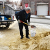 Bob Ellis of Fitchburg shovels sand, put out by the Fitchburg DPW, into a bucket to take home in preparation for the snowstorm this weekend, Friday.<br /> SENTINEL & ENTERPRISE / BRETT CRAWFORD