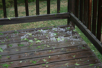 Pieces of hail on our deck.