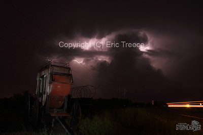 Old west wagon near Kearney, NE and supercell storm in the distance.