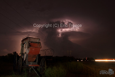 Old west wagon near Kearney, NE and supercell storm in the distance