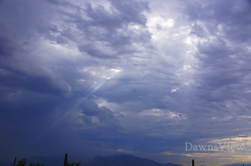 August Morning Storm allows a bit of sun to shine through, August 12, 2011