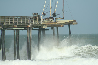 Rodanthe Pier being repaired once more!  These poor guys were losing their hard hats it was so windy!