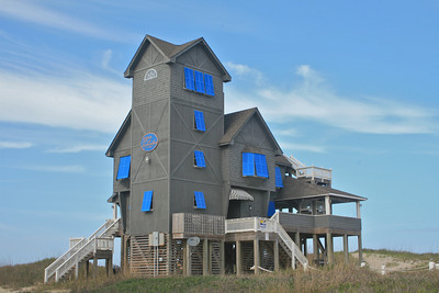 "The Inn at Rodanthe which was featured in the movie ""Nights in Rodanthe.""   A man bought this as a Valentine's Day gift for his wife!  It was moved a couple of blocks from the filming location due to erosion of the beach.  After a couple of years it is getting closer to the beach!"