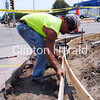 Tony Trickle, of Clinton Engineering, works on the corner of South Second Street and Sixth Avenue South. Heat indexes at that time reached almost 110 degrees. • Scott Levine/Clinton Herald