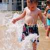 Lucas Hewitt, 21 months, of Clinton, plays in the splash pad at the Riverview Pool. Children and adults flooded the pool June 28 as heat indexes topped 110 degrees. • Scott Levine/Clinton Herald