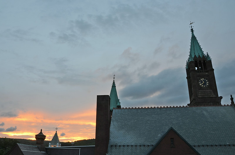 A sunset is seen behind Faith United Parish in Fitchburg on Tuesday evening. SENTINEL & ENTERPRISE / ASHLEY GREEN
