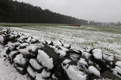 Mid-April snow leaves patterns on the fields along East Street in Tewksbury.  JULIA MALAKIE/LOWELLSUN