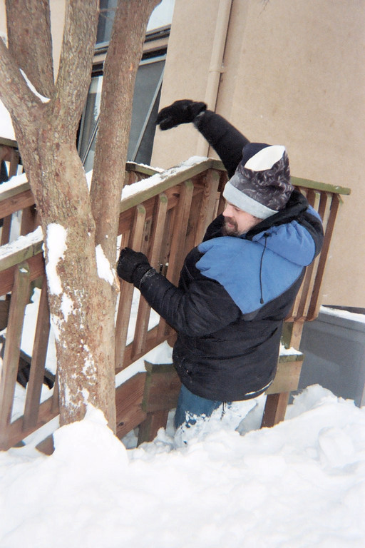 Ken finally freed the heat pump vents, but the snow was soft and the waist-high deck was too high for him to climb back up. He didn't know how to get out! <br /> <br /> He finally managed to get through by hanging on to the deck for leverage as he pushed laboriously through the hip-deep snow.