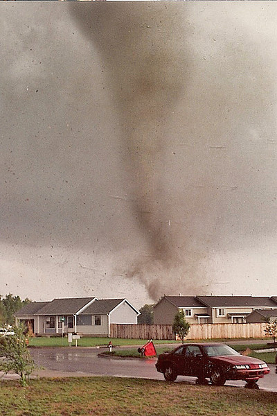 This photo and the 2 that follow are of the April 26, 1991 tornado that hit Haysville, Wichita and Andover, Kansas.  This tornado took 13 lives that day.  These photos were taken from my front yard in south Wichita.  Tornado got  within about 1/4-1/2 mile away from my house.  Photos were taken with a Pentax ME Super on ISO 400 film and these are scans of those pictures.