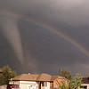 "This was the last photo of about 40 I snapped that day as the tornado came by.  It disappeared into clouds right after this picture and is just about to hit McConnell AFB here.<br /> <br /> I had the lab print some of these with the statement that ""even in the worst of times there's a rainbow of hope.""  They sold like hotcakes."
