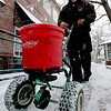 "Lance Rouse, of the City of Boulder Parks and Recreation, puts down crystals to melt the ice on Pearl Street.<br /> People in downtown Boulder go about their day during a Valentine's Day snow on Thursday.<br /> For more snow photos and a video, go to  <a href=""http://www.dailycamera.com"">http://www.dailycamera.com</a>.<br />  Cliff Grassmick  / February 14, 2013"