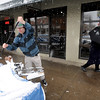 "Andrew Schneider of University Bikes clears snow from covered bicycles.<br /> People in downtown Boulder go about their day during a Valentine's Day snow on Thursday.<br /> For more snow photos and a video, go to  <a href=""http://www.dailycamera.com"">http://www.dailycamera.com</a>.<br />  Cliff Grassmick  / February 14, 2013"