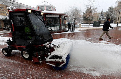rews from the City of Boulder Parks and Recreation work to remove the snow on the Pearl Street Mall. People in downtown Boulder go about their day during a Valentine's Day snow on Thursday. For more snow photos and a video, go to www.dailycamera.com.  Cliff Grassmick  / February 14, 2013
