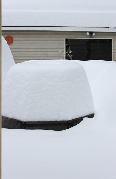 The requisite patio-furniture-in-snow shot.