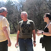 From left, Dave Williams of Newburyport meets up with Alan Sargent of Rehoboth and Jamie Marcolongo of Billerica while walking at Vietnam Veterans Park in Billerica during lunch break. They all work at South Shore Gunite Pools nearby. (SUN/Julia Malakie)