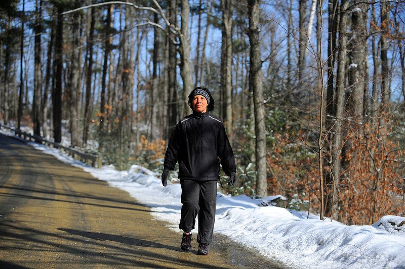 Betty Berthiaume of Lunenburg takes in the sunny, mild weather on Tuesday with a walk at Coggshall Park in Fitchburg. The National Weather Service is forecasting 10-14 inches of snow on Wednesday.<br /> SENTINEL & ENTERPRISE / BRETT CRAWFORD