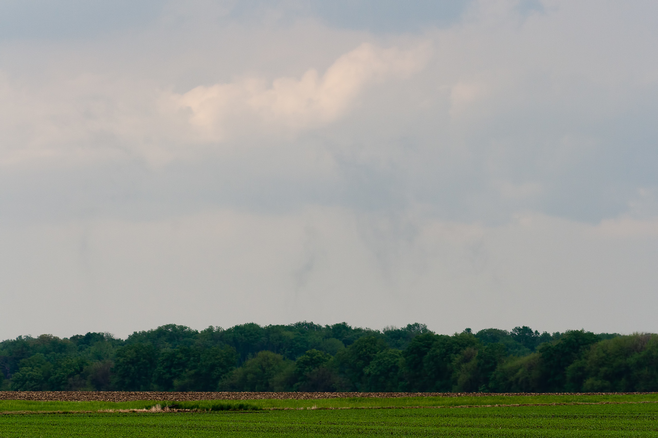 Brief landspout funnel under developing cell.