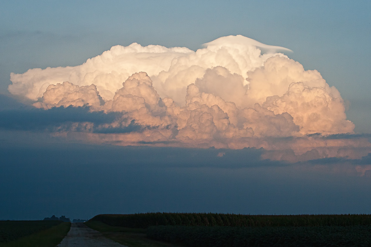 "The ""hat"" looking cloud is called a Pileus Cap."