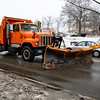 A Leominster DPW truck scrapes Center St. of slush and ice on Monday.<br /> SENTINEL & ENTERPRISE / BRETT CRAWFORD
