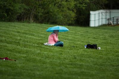 Girl on the phone in the rain.