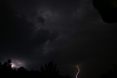 Severe thunderstorm passing through.  Cloud illumination is due to cloud-to-cloud lightning strikes.