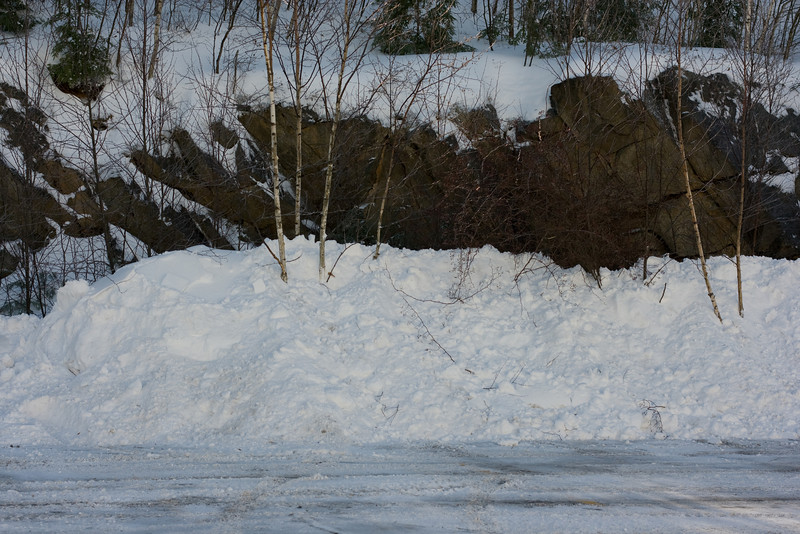Snow piled high in our parking lot.