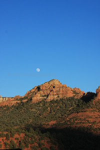 Moon rising over Camelhead Rock in Sedona, AZ.