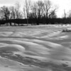 Garden beds blanketed in snow to look like a giant quilt. Converted to B&W for effect.