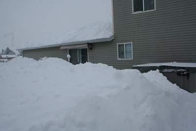 You almost cant's see our house because the snow is piled up so high.