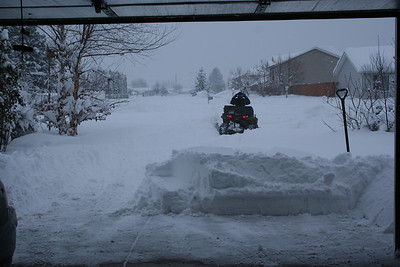 Pat started plowing all the snow. There was about a 3 plus foot snow drift over our driveway.