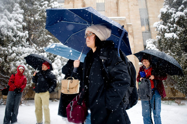 Yeeling Foo, visiting from Atlanta, participates in a photography class on the Pearl Street Mall in the midst of a winter storm that was expected to drop near a foot of snow throughout the day Friday, March 19, 2010.  <br /> <br /> KASIA BROUSSALIAN