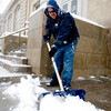 Jason Shoeman, an employee for the downtown U.S. Post Office, shovels snow near the front steps in the midst of a winter storm that was expected to drop near a foot of snow throughout the day Friday, March 19, 2010.  <br /> <br /> KASIA BROUSSALIAN