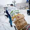 Steve Zabel, an employee of Sysco Denver,  carries in produce to Boulder Cafe on the Pearl Street Mall in the midst of a winter storm that was expected to drop near a foot of snow throughout the day Friday, March 19, 2010.  <br /> <br /> KASIA BROUSSALIAN