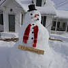 Snowman on Old Westford Rd in Chelmsford after Nor'easter. It also had a face on the side facing the house. (SUN/Julia Malakie)