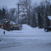 """Plowing some snow across the rail road tracks from the local coffee shop I was took a picture of while waiting for some hot chocolate . <a href=""""http://eatery.goodnewsmorris.info/commoncup.html"""">http://eatery.goodnewsmorris.info/commoncup.html</a>"""