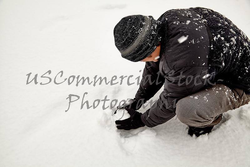 young man making snowball