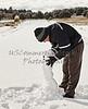 man building a snowman