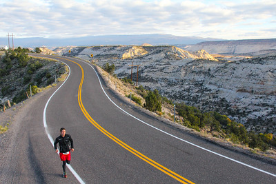 One of the Escalante Canyons Marathons' most Memorable Moments for the Runners, is to cross the Hogsback. This stretch of National Scenic Hi-Way 12 has no Guardrails and a drop of 400 feet on either side. The View is Spectacular looking East over Boulder Creek out towards the Burr Trail, and WaterPocket Fold. South to Navajo Mountain 70 miles away over a Painted Desert of Slick Rock Canyons and under Crystal Blue Skies.  To the west and 400 feet below the road the Canyon formed by Calf Creek cuts through the Sandstone walls an is nestled below the Death Hollow Wilderness. On the horizon the Vermillion Cliffs and famous Powell Point.  To the North the beautiful Boulder Mountain rises to over 10,000 feet with the Fall Foliage just beginning to turn. This is the most Beautiful Marathon you will ever run.