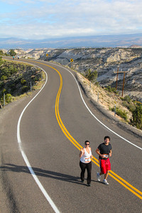 One of the Escalante Canyons Marathons' most Memorable Moments for the Runners, is to cross the Hogsback. This stretch of National Scenic Hi-Way 12 has no Guardrails and a drop of 400 feet on either side. The View is Spectacular looking East over Boulder Creek out towards the Burr Trail, and WaterPocket Fold. South to Navajo Mountain 70 miles away over a Painted Desert of Slick Rock Canyons and under Crystal Blue Skies.  To the west and 400 feet below the road the Canyon formed by Calf Creek cuts through the Sandstone walls an is nestled below the Death Hollow Wilderness. On the horizon the Vermillion Cliffs and famous Powell Point.  To the North the beautiful Boulder Mountain rises to over 10,000 feet with the Fall Foliage just beginning to turn. This is the most Beautiful Marathon you will ever run