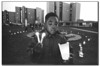 Chicago, IL - File Photo- A small boy holds three candles for friends that were killed or injured by hand guns in the Chicago Housing Authority in 1993 as part of a prayer/candlelight vigil held each month to remember those killed by gang violence. The vi