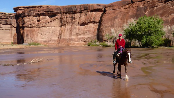 Linda enjoying a horseback ride in Canyon de Chelly, Arizona.