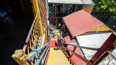 Linda navigating her way down one of the many steep colorful staircases in La Boca, Buenos Aires.